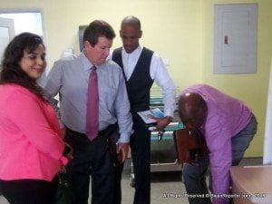 From left, Kavita Williams and Trustee of the Ivy-Viola Williams Foundation Paul Williams, Pastor Andre Symmonds while CEO Dexter James examines a new feature at the launch.