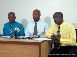 Police Public Relations Officer ASP (Ag) David Welch (right) making a point during ihe Press conference at Police Headquarters. On extreme left is Acting Assistant Superintendent Jefferson Clarke and in Centre is Acting Inspector of the Financial Crimes Unit, Mark White.