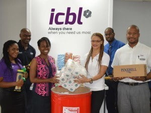 President of the ICBL Social Club, Heather Walton (third from right) presented Stacia Whittaker, HIV/AIDS Foodbank Manager, with the food and toiletry items donated by staff.