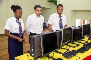 L to R: Miss Shanice Woodley - Prefect, Mr. Manuel Toro - Arawak GM and Stephen Whittaker - Head Boy