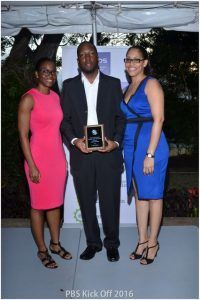 Jabar Caddle with Corporate Sales Manager, Maria Thompson (right) and Facey Barbados Chief Finance Manager, Lois Denny (left)