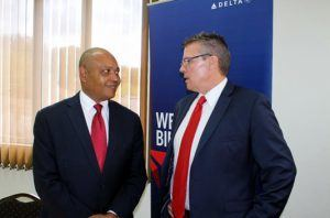 Richard Pile, Regional District Sales Manager ESC/Haiti, a sponsor of the event, speaking with Dustin Delany, President of AmCham BEC