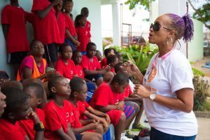 Soca Queen Allison Hinds having a motivational talk with the participants of the soccer camp.