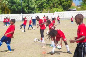 Some of the participants of the soccer camp going through the paces