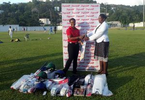 Digicel St Lucia Country Manager, Siobhan James-Alexander, hands over cricket equipment to Manager of the St Lucia Female Cricket Team, Eugena Gregg
