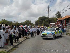 """The march required everyone to wear """"white"""" and proceed from Parliament Building to Browne's Beach, just a stone's throw from the Office of The Prime Minister, where the regular Cabinet meeting was in session."""
