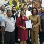 Members of the Food Safety Management Team pose with Marsha Williams and 	their HACCP certificate