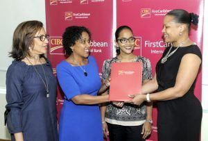 Donna Wellington Managing Director for CIBC FirstCaribbean International Barbados,presents the final agreement and cheque to Renee Kowlessar Director and Trustee of the Cherry Tree Trust while Sheila Leacock (left) and Sasha Sheehy, both General Managers of the Trust share in the moment.