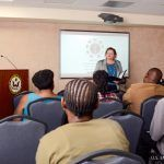 Caption: Deputy Chief of the U.S. Mission to Barbados, the Eastern Caribbean, and the OECS, Laura Griesmer (standing) delivers remarks to participants at the U.S. Embassy's interactive program to prevent LGBTI hate crimes.