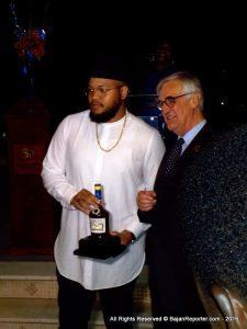 Rihanna's brother acted on her behalf as he received a Limited Edition bottle celebrating Barbados' 50th Anniversary of Independence.