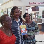 Two sisters are suddenly sent from their home in Brooklyn to Barbados to live with their grandmother, in this stunning debut novel. Naomi at centre, seen here with two of her fans at Haggatt Hall.