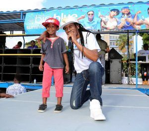 Flow ambassador Lil Rick shares the spotlight with five year-old Jonari Beckles during the company's recent 'Big Blue Live' concert in Heroes Square.