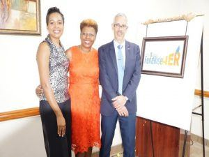 Valrie Grant, the Commonwealth Woman Entrepreneur of the Year, A. Cecile Watson, CEO of pitchandchoose.com and Dominic Gaskin, Minister of Business.