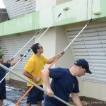 Sailors from the USS John P. Murtha paint the Gordon Walters Primary School in St. Patrick's, Christ Church, ahead of the start of the new school year