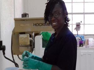 Jewel Brewster who joined the Harris Paints Technical team seen here checking reflective paint pigments