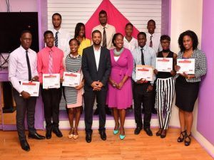 World of Work interns proudly display their certificates of completion. Scotiabank Director of Corporate & Commercial Banking Victor Boyce (fourth from left) and Marketing Manager Amanda Lynch-Foster (fourth from right) share the moment with them.