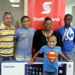 (from left to right) Prize winners Philip Best, Christian Best, Marcia Best, Kobe Williams-Phillips and Zachary Best in front, smiling as they receive their winnings