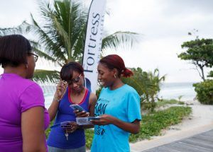 A Random Acts of Fitness team member encourages exercise enthusiasts on the Richard Haynes Boardwalk to support the Fortress Half Marathon