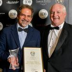 Gregor Nassief, proprietor of Secret Bay,  (Left) receiving the top honor at Merchant Taylors Hall in London