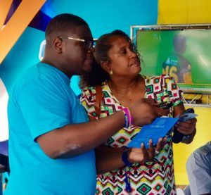 Hakeem Applewhaite, a Flow Tech Expert, shows customer Lisa Ashby some of the features of Flow EVO during a recent exhibition.
