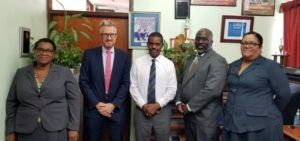 From left, Permanent Secretary in the Ministry of Education Chandler Hyacinth; UK Government representative Mr. Mark George; Dominica's Minister of Education Mr. Peter Saint Jean; UK Government representative Terry Brathwaite; and Chief Education Officer Melanie Fontaine; stand for a photo opportunity after their meeting.