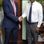 Dominica's Minister of Education, Mr. Peter Saint Jean (right) shakes hands with UK Government representative Mr. Mark George, after meeting to discuss youth development on the island.