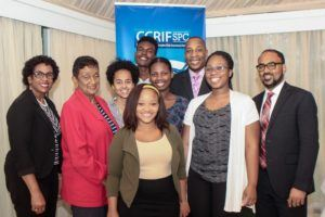 CCRIF-UWI undergraduate scholarship recipients with (2nd row left) Mrs. Beverly Hunter, Snr. Administrative Officer at UWI; Mrs. Desirée Cherebin CCRIF Board Member and Chairperson of the Technical Assistance Committee; Mr. Timothy Antoine (back row, right), CCRIF Chairman; and Mr. Isaac Anthony, CCRIF CEO (2nd row, far right)