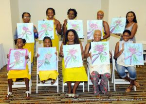 A group of the 'painters' showing off their completed picture.
