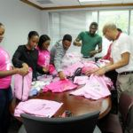 Carolann Nurse (left) and her team sort out and pack the bags, readying them for collection by staff.