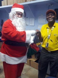 "The jolly old elf also spent time with staff wishing the best for this Yuletide and one stood out expecially for St Nick, he met David Harding who is a repair technician working at Barbados Lotteries and now retiring after 22 years. Santa asked Mr Harding how he managed to keep pace with the technology of ticket dispensing machines, and he told Santa; ""You learn something new every day - you never stop learning!"""