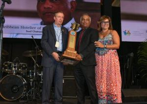 Hotelier Sunil Chatrani (center) receives his award from CHTA's Director General Frank Comito (left) and CHTA President Patricia Affonso-Dass.
