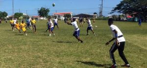GIR Barbados children learning to play rugby
