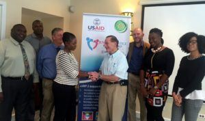 Counselling Psychologist and Trainer Dr. Barry Glick, greets Senior Probation Officer from Barbados Roseanne Green. Looking on (third from left) is USAID Mission Director Christopher Cushing, USAID General Development Officer, Kipp Sutton (third from right) and other social services officers from Barbados and St. Lucia.