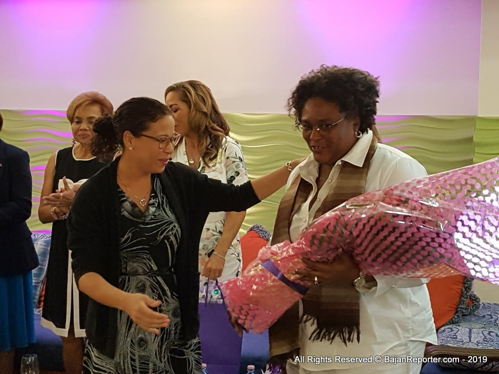 AmCham BEC Director Shelly Ann DaSilva Hee Chung presents bouquet to Rt. Hon. Mia Amor Mottley, 8th PM of Barbados at Radisson Aquatica