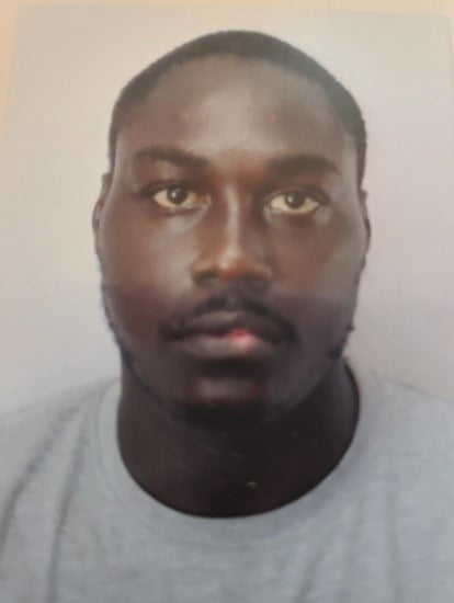 He is about 6 feet tall, medium build, dark complexion and has low black hair. Kadesh has full brown eyes which are set close together, a broad nose, thick lips with a square chin. He walks with an erect appearance and speaks with a Guyanese accent. He was last seen wearing a Gray Tee shirt, a Khaki 3/4 cargo pants and red slippers. It is suspected he has a mental history.