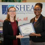 Keisha Gustave accepting a SHEA Certificate in Healthcare Epidemiology from SHEA President, Dr Hilary Babcock.