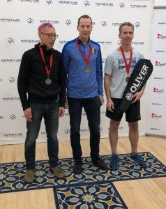 MARK SEALY (center) Canadian 55+ Champion, with silver medalist Bill Lam (left) and bronze medalist Tom Powers (right)