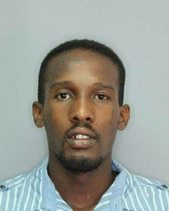 The 26 year old is wanted for questioning in connection with a serious criminal matter. Harris is of a dark brown complexion, approximately 6 feet 2 inches tall and of a slim built. He has a prominent forehead with the image of two stars and the letters '<strong>A B A</strong>' tattooed on the left side of his forehead and an image of a cross tattooed on the left cheek and four tear drops tattooed next to his right eye along with a scar over his right eye. In addition, Harris has a tattoo of the letters MOB on his left arm.