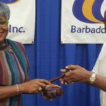 Pic A Past President hands over New President