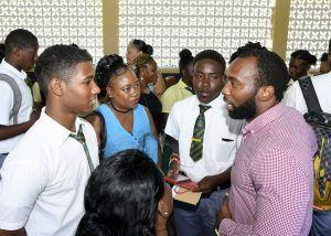 Mentor Maurice Arthur, right, speaking with interns, Shakeel Gilkes, left, and Jamie Lawson, second from right. Jamie's mother, Jennifer Lawson is second from left while Shakeel's mother, Janice Holder is partially hidden.