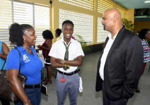Anthony Ali (right) talking with one of the interns and a parent.
