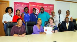 Standing From Left: Trudy King Chief Accountant at the Bank; Debra King Head of Corporate Communications at the Bank; Keisha Russell-Grannum, Sandra Stuart, Dwayne Goddard and Shelley Boyce all from KC Barbados, Dr Benskin and Annette Slocombe from the QEH Sitting front from Left: Managing Director Barbados and OECS Donna Wellington; Roseann Myers, Colette Delaney and Tony Harris