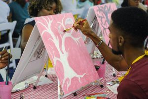 One of the participants working on his painting