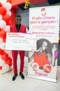 Emerson 18yo amateur football player from Haiti is the winner of Digicels Shake to Win Christmas promotion regional grand prize.