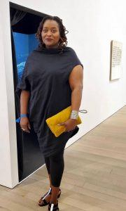 An elegant Deborah Jack, with her artwork on exhibit at a recent show in the USA. (© DJ photo.)