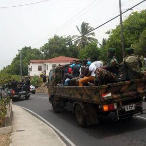 Witnesses watched and video-taped the mid-day operation of law enforcement officers apprehending several persons said to be nationals of Haiti.