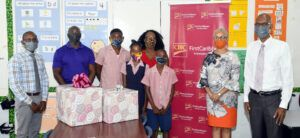 Tarik Harris, Nahki Walrond and Lanise Taylor received their special prizes from senior officials of CIBC FirstCaribbean's Marketing and Communications, Culture and Engagement Department. Harris received his gift from Senior Manager Operating Companies, Marketing Dwight Thompson who said he was glad to have chatted with Harris prior to the presentation ceremony. Harris had told him he was confident that he had done well in the exam and was looking forward to enjoying outdoor activities during the coming holidays.