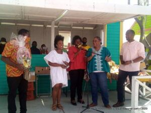 (CLICK FOR BIGGER) Jr Finance Minister Marsha Caddle (2nd from Left) plus Maritime Affairs & Blue Economy Minister Kirk Humphrey lead a lusty chorus of Happy Birthday for President of the Barbados' Vendors and Entrepreneurs' Association (BARVEN) Alistair Alexander