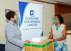 In our photo: Valerie Lovell, Head Office People Coordinator of Goddard Enterprises presents the masks to Stacia Brewster of the Diabetes Association.