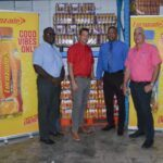 From left: Sgt. David Alleyne, Barry Muster Sales Supervisor at Collins Limited, Acting Inspector Rodney Inniss Police Public Relations Officer, and Michael King Executive Assistant at Collins Limited during the presentation.